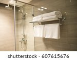 clean white towel on a hanger... | Shutterstock . vector #607615676