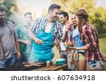 friends having a barbecue party ... | Shutterstock . vector #607634918