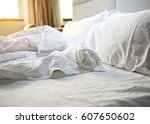 close up of messy bedding... | Shutterstock . vector #607650602