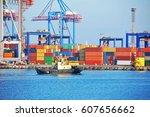 tugboat and crane in harbor... | Shutterstock . vector #607656662