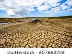 dry desert cracked ground...   Shutterstock . vector #607663226