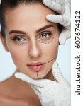 facial beauty treatment.... | Shutterstock . vector #607674122