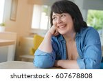 portrait of smiling 50 year old ...   Shutterstock . vector #607678808