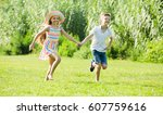 two cheerful smiling children... | Shutterstock . vector #607759616