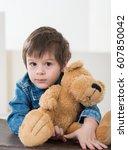 little boy sitting on the... | Shutterstock . vector #607850042