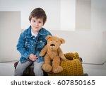 little boy sitting on the... | Shutterstock . vector #607850165