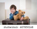 little boy sitting on the... | Shutterstock . vector #607850168