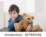 little boy sitting on the... | Shutterstock . vector #607850186