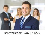 smiling businessman  in office... | Shutterstock . vector #607874222