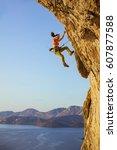 female rock climber falling off ...   Shutterstock . vector #607877588