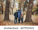 two boys standing in the park... | Shutterstock . vector #607923422
