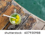 mojito coctail on a wooden... | Shutterstock . vector #607930988