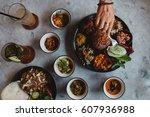 nasi campur  asian dish made of ... | Shutterstock . vector #607936988