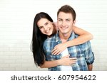 couple in his new home.... | Shutterstock . vector #607954622