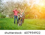 happy child riding bicycle... | Shutterstock . vector #607954922