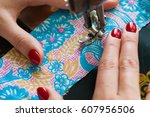female hands sewing on old...   Shutterstock . vector #607956506