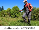 pesticides spraying. farmer... | Shutterstock . vector #607958048