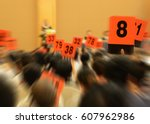 people holding auction paddle... | Shutterstock . vector #607962986