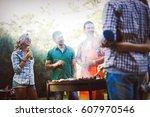 friends having fun grilling... | Shutterstock . vector #607970546