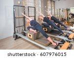 young women exercising on... | Shutterstock . vector #607976015