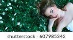 beautiful young girl lies on a... | Shutterstock . vector #607985342