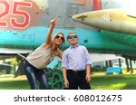 Mother and her son in the museum of aviation, and shows him on a plane in the sky