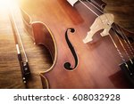 cello on wood background with... | Shutterstock . vector #608032928