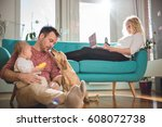 father sitting on the floor and ... | Shutterstock . vector #608072738