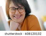 cheerful woman with eyeglasses... | Shutterstock . vector #608120132