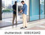 man using his credit card in an ... | Shutterstock . vector #608141642