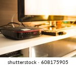 digital tv box and smart tv in... | Shutterstock . vector #608175905