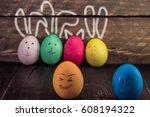 funny easter egg on wooden... | Shutterstock . vector #608194322