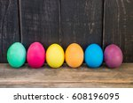 row of colorful easter eggs on... | Shutterstock . vector #608196095