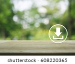 download icon on wooden table... | Shutterstock . vector #608220365