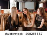 young friends in a cafe | Shutterstock . vector #608255552