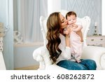 mother with baby   Shutterstock . vector #608262872