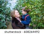 beautiful woman holding her... | Shutterstock . vector #608264492