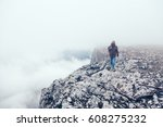 man with backpack trekking in... | Shutterstock . vector #608275232