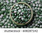 lots of pills of spirulina  ...   Shutterstock . vector #608287142
