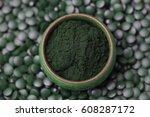 ground spirulina and spirulina...   Shutterstock . vector #608287172