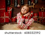 little girl in pajamas laughing.... | Shutterstock . vector #608332592