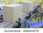 automation   cardboard boxes on ... | Shutterstock . vector #608344376