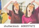 two female friends holding... | Shutterstock . vector #608357672