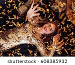 happy glamour woman on a gold... | Shutterstock . vector #608385932