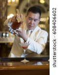 chinese barman is making fruit... | Shutterstock . vector #608406602