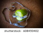 dieting concept green apple... | Shutterstock . vector #608450402
