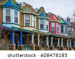colorful row houses along... | Shutterstock . vector #608478185