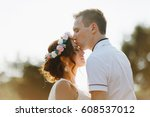 groom with the bride on a walk | Shutterstock . vector #608537012