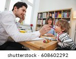 young happy modern family  at... | Shutterstock . vector #608602292