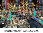 souvenirs offered on a market ... | Shutterstock . vector #608659925